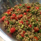 Cold Lentil Salad - Lentils are combined with roasted garlic, sweet grape tomatoes, and plenty of parsley and served with a simple balsamic dressing for a salad that makes a nice lunch or light supper.
