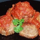 The Best Meatballs - Meatballs made with ground beef, veal and pork, with garlic and Romano cheese. Finish cooking in your favorite marinara sauce.