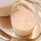 Coquito - Very yummy creamy tropical coconut eggnog made with spices and white rum. It is always requested at my holiday gatherings. (And sometimes gets selfishly hidden in the fridge by the hostess.) Serve in glass cups and sprinkle with more cinnamon if desired. Feliz Navidad!