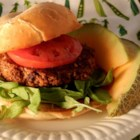 Black Bean and Walnut Burgers - Hearty and nutty, these black bean burgers are made with cooked sweet potato, walnuts, Fresno chile pepper, rolled oats, and flaxseed.