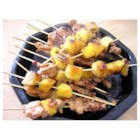 Sizzling Chicken Skewers  - The chicken is marinated in a soy sauce, brown sugar and peanut butter (just to name a few of the ingredients), then grilled or broiled. Delicious.