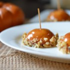 Caramel Apple Cookies - Apple juice-infused sugar cookies are coated in caramel and walnuts to look like miniature caramel apples. Serve at Halloween parties and fall get-togethers.