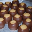 Buckeye Balls - Peanut butter balls dipped in chocolate. They look like buckeye nuts.  Absolutely delicious!