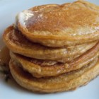 Easy Pumpkin Pancakes - Thanksgiving breakfast gets the royal treatment with this delicious recipe for quick and easy pumpkin pancakes that taste just like pumpkin pie!