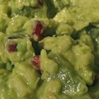 Holiday Guacamole - I tried this recipe at a friend of the family's. It is such a great twist to traditional guacamole. I wanted others to be able to try this. This not only tastes great but it looks nice as well. Don't be scared off by the ingredients, it is great with unsalted tortilla chips!