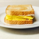 Tom's Scrambled Egg Sandwich - Sandwich scrambled eggs between two slices of toast with a little mustard and mayo in this recipe that's been handed down through the generations.