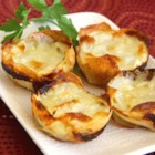 Muffin Tin Potatoes Gratin - Individual-size portions of au gratin potatoes are made simple with the help of a muffin tin and 6 ingredients.