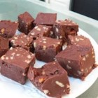 No-Cook Never-Fail Fudge - This recipe came from a dear friend of mine. It is an unbelievably delicious fudge!  This fudge has been a hit with all who have tried it.  Don't let them know the ingredients until they have tasted it; they still won't believe it has cheese in it.  Also, it is easier to make if the recipe is halved. Pecans can be substituted for walnuts.