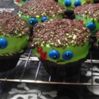 Frankenstein Cupcakes - Cupcakes are frosted with green frosting, chocolate candies, and food gel creating Frankenstein cupcakes perfect for Halloween parties.