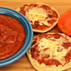 Easy No-Cook Pizza Sauce - When you need a pizza sauce in a hurry, try this recipe requiring only tomato sauce, onion powder, sugar, oregano, and garlic pepper.