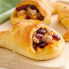 Sausage-Stuffed Crescent Cornucopias - Using Pillsbury(TM) crescent rolls, you can make these awesome tasty cornucopias to serve as an appetizer or a side to your dinner.
