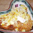 Baked Corn II - This simple recipe combines whole kernel corn, milk, egg, and butter for a side dish everyone will love.