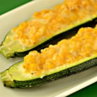 Corn-Stuffed Zucchini - Zucchini stuffed with corn and Mexican cheese blend is a quick and easy side dish or appetizer that everyone will love.