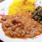 Slow Cooked Baked Beans - Beans slow cooked with onions and pork and sweetened with brown sugar and molasses.