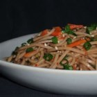 Oriental Cold Noodle Salad - A spicy, Thai-inspired soba noodle treat that's great for picnics and barbecues. For a Japanese-inspired version, omit the pepper flakes, peanuts, and cilantro; and add toasted sesame seeds.