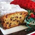 Christmas Cherry Cake - This is a lovely white cake studded with glace cherries and golden raisins-a nice alternative to fruitcake. This loaf freezes well, too.