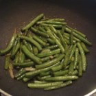 Sauteed String Beans - Tired of regular or canned string beans? Here's an easy way to flavor up those veggies! Even my string bean hating roommate loves these!