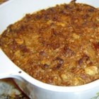 Yam Casserole - Yams are baked with butter, sugar, evaporated milk, eggs and spices,  and topped with a mixture of butter, brown sugar and sugar frosted corn flake cereal.