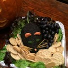 Dead Man's Cheese Ball - Serve this black cheese ball with blue corn chips or dark rye toast for a ghastly presentation. It's punchy, just like you'd expect cheese of the dead to taste. You can find black sesame seeds at a reasonable price at most Asian markets.