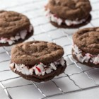 Triple Chocolate-Peppermint Sandwich Cookies - A creamy mint chocolate filling is sandwiched between double chocolate cookies for a festive holiday treat.