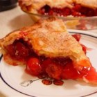 Perfect Cherry Pie - Cherry pie is just about the easiest fruit pie to make. Sour cherries -- the kind you need for pie -- are rarely available fresh or frozen, so the canned variety usually is the only option for most cooks. Not only do canned cherries make good pies, but there's also no peeling, coring, seeding, pitting or slicing the fruit. Just drain, dump, sweeten, flavor and thicken, and you're in business.