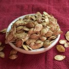 Sweet Vanilla Cinnamon Pumpkin Seeds - These sweet pumpkin seeds are baked with vanilla bean sugar and cinnamon.