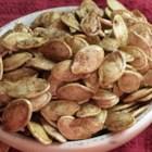 Sweet Vanilla Cinnamon Pumpkin Seeds - These sweet pumpkin seeds are baked with vanilla bean sugar and cinnamon.