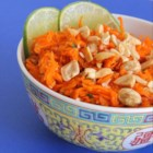 Thai Carrot Salad - This recipe for Thai carrot salad with peanuts is a perfect balance of sweet and spicy with hints of garlic and curry in the dressing.