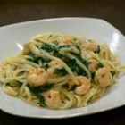 New Year Spinach Fettuccine with Scallops - The sharp flavor of spinach wilted in oil combines perfectly with fresh scallops sauteed lightly in garlic and oil, tossed with hot fettuccine, and served with a delectable sauce of cream of mushroom soup, fresh mushrooms and white wine.