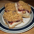 Cranberry Cheese Bars - A tasty layered bar cookie with an oaty crust, a cream cheese layer and a cranberry layer.