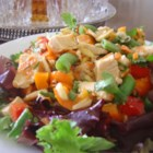 Almond Chicken Salad - This fresh tasting salad has crisp green onions, carrots, red peppers, snow peas and almonds tossed with chicken breast meat in a tangy Asian dressing.  Delicious!
