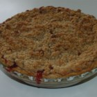 Strawberry Rhubarb Pie III -  Orange zest and tapioca are stirred into the strawberry-rhubarb filling, making this sweet pie especially luscious and citrusy. Choose either a top crust or a crumb topping.