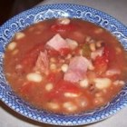 New Year's Day Black-Eyed Peas - See in the new year with a hearty bowl of black-eyed peas cooked with garlic, onion, tomatoes and diced country ham. A real country ham is quite salty, but the flavor and seasoning is just right for this homey dish.