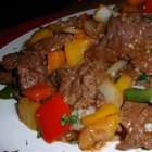 Succulent Ribeye and Peppers - Seared rib-eye steaks are sprinkled with fajita seasoning mix and simmered in a covered pot with sauteed bell peppers, onions, garlic, and lime juice.