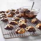 Cranberry Chocolate-Dipped Cookies - Try a dip of deliciousness. Made with walnuts, dried cranberries and a secret ingredient, these chocolate-dipped chocolate chip cookies are scrumptious.