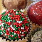 Easy Decadent Truffles - Insanely easy, but oh so rich!  Recipe makes a large amount but you can vary flavorings and coatings to make several different varieties.