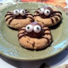 Peanut Butter Spider Cookies - Turn peanut butter cookies into a fun, kid-pleasing Halloween treat by using chocolate truffles and frosting to decorate them with spiders!