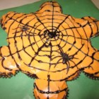 Pull-Apart Spider Web Cupcakes - Treat your family and friends to the perfect Halloween dessert; pull-apart spider web cupcakes frosted with whipped topping.