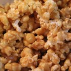 "Sticky Popcorn - Marshmallows, butter, and brown sugar are melted together and poured over popcorn creating a fun snack for the kids called ""sticky popcorn""."