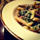 Penne with Ham and Parmesan - This is a full-on penne pasta dish recipe with ham, mushrooms, and spinach in a Parmesan cheese sauce flavored with basil.
