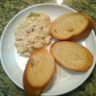 Baked Crab and Artichoke Dip - This baked crab and artichoke dip is made and served in a bread bowl that you can eat too!