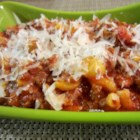 Kicked-Up Goulash - This mixture of beef and macaroni uses prepared spaghetti sauce, pearl onions, corn, and Italian seasoning for an easy dinner for the whole family.