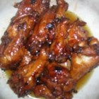 Sesame Oil Chicken Wings - Soy sauce and sesame oil provide a rich glaze for chicken wings.  A complete meal can be made of this appetizer, simply by adding your favorite vegetables.
