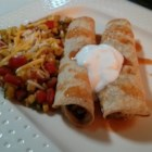 Quick and Easy Chicken Taquitos - Homemade chicken taquitos filled with beans, green chile peppers, and cheese are quick and easy to prepare and will make the whole family happy.