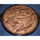 Chocolate Peanut Butter Pie I - First you make a chocolate filling and spoon it into a chocolate crust. Then you make a peanut butter filling and swirl it into the chocolate. Drizzle melted chocolate over the top, and chill.