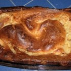 Yorkshire Pudding II - Flour, salt, milk and eggs, along with roast beef pan drippings, make this classic Yorkshire pudding to serve with roast beef.