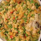 Tuna Noodle Casserole III - Colorful carrots, broccoli and red bell peppers find their way into a familiar casserole of tuna, celery, onion and cream of mushroom soup. Sprinkle with Cheddar cheese and bake until warm and bubbly.