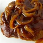My Kid's Favorite Pork Chops - Chops simmered in beer and tangy barbeque sauce, topped with onions.