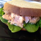 Simple Salmon and Spinach Sandwiches - Make a simple salmon salad with canned salmon and thousand island dressing, and serve on toast with spinach leaves.