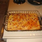 Spam and Cheese Casserole - A mixture of the famed luncheon meat, eggs, soda cracker crumbs, milk and Cheddar cheese baked to a full flavored finish.